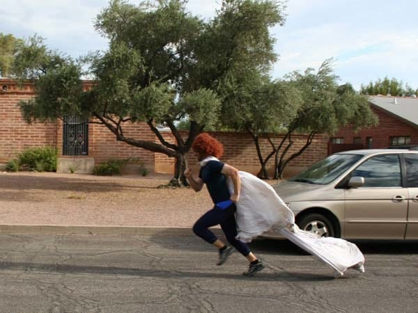 It's a bride! It's a pain!... oh no, it's just a newly single and awesome guy.