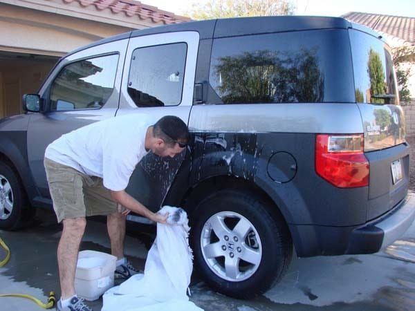 He also tried washing cars, but it turns out that wedding dresses don't hold water very well.