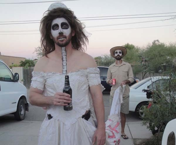 Tucson, AZ, hosts a Day of the Dead celebration every year. His costume was a smash hit.