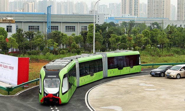 China Unveils World's First 'Smart Bus' That Runs On Painted White Lines